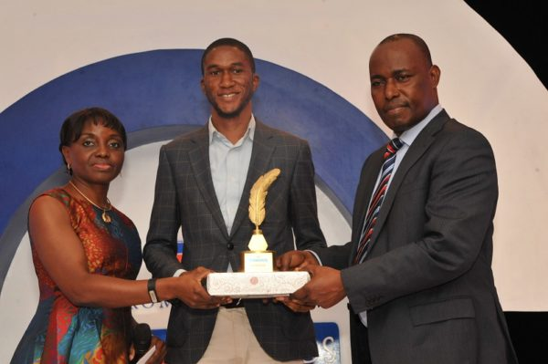 Tobi Aworinde, winner, Education Reporter of the Year (m); receiving his award from Judy Okolo, Senior Manager, Promasidor Nigeria Limited (l); and Martins Oloja, former Editor/member Editorial Board, Guardian newspapers; at the 2016 Promasidor Quill Awards event held at Sheraton Lagos Hotel …recently