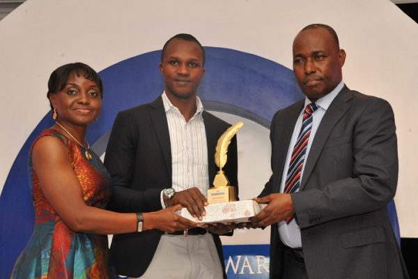 Tunde Ajaja, winner, Future Writer of the Year (m); receiving his award from Judy Okolo, Senior Manager, Promasidor Nigeria Limited (l); and Martins Oloja, former Editor/member Editorial Board, Guardian newspapers; at the 2016 Promasidor Quill Awards event held at Sheraton Lagos Hotel …recently