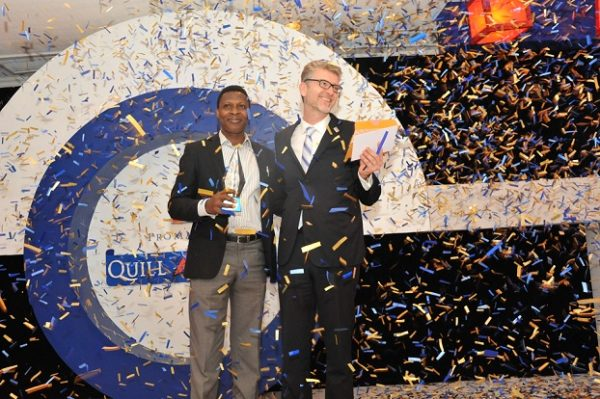 Ajibola Amzat, overall winner; receiving his award from Olivier Thiry, Managing Director, Promasidor Nigeria Limited; at the 2016 Promasidor Quill Awards event held at Sheraton Lagos Hotel …recently