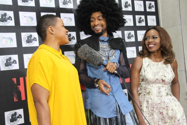 Denrele interviewing guests on the Red Carpet