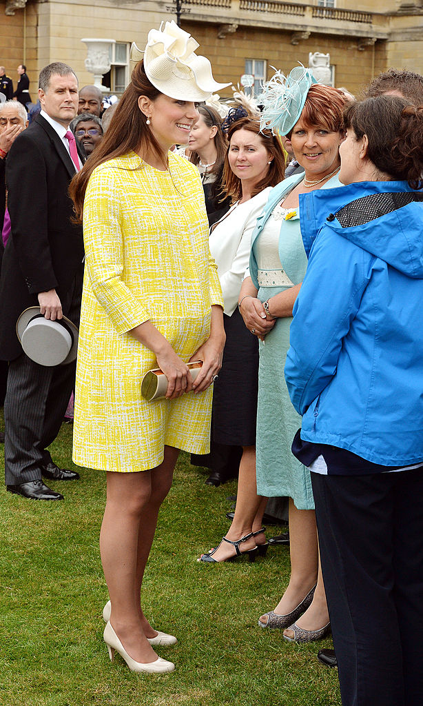 LONDON, ENGLAND - MAY 22: Catherine, Duchess of Cambridge talks to guests as she attends a Garden Party in the grounds of Buckingham Palace hosted by Queen Elizabeth II on May 22, 2013. (Photo by John Stillwell - WPA Pool/Getty Images)