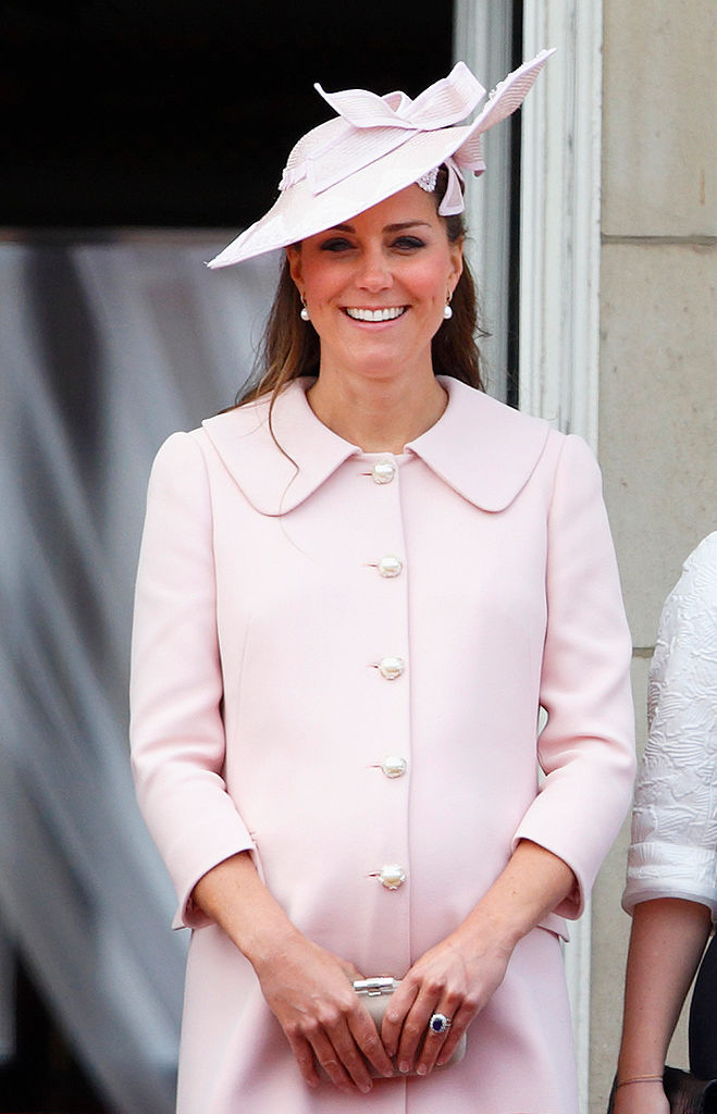 LONDON, UNITED KINGDOM - JUNE 15: (EMBARGOED FOR PUBLICATION IN UK NEWSPAPERS UNTIL 48 HOURS AFTER CREATE DATE AND TIME) Catherine, Duchess of Cambridge stands on the balcony of Buckingham Palace during the annual Trooping the Colour Ceremony on June 15, 2013 in London, England. Today's ceremony which marks the Queen's official birthday will not be attended by Prince Philip the Duke of Edinburgh as he recuperates from abdominal surgery. This will also be The Duchess of Cambridge's last public engagement before her baby is due to be born next month. (Photo by Max Mumby/Indigo/Getty Images)