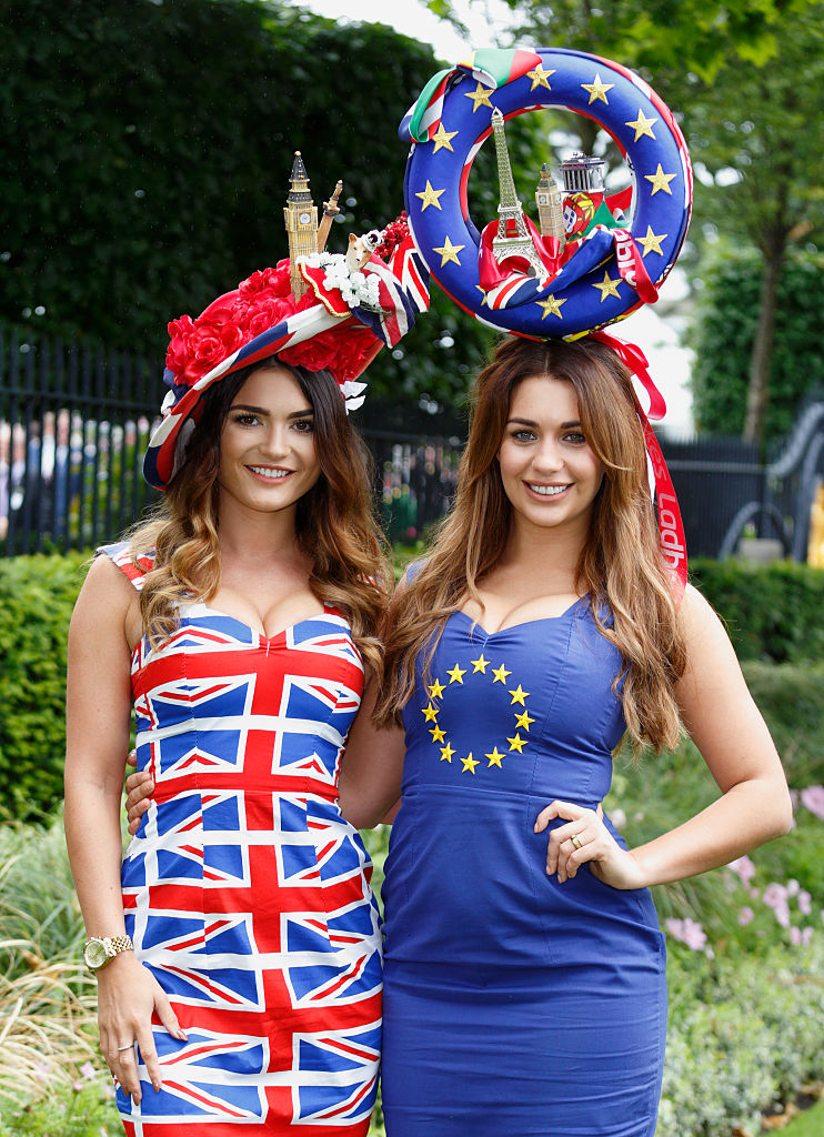 ASCOT, UNITED KINGDOM - JUNE 14: (EMBARGOED FOR PUBLICATION IN UK NEWSPAPERS UNTIL 48 HOURS AFTER CREATE DATE AND TIME) Women wearing Union Flag and European Union design dresses and hats attend day 1 of Royal Ascot at Ascot Racecourse on June 14, 2016 in Ascot, England. (Photo by Max Mumby/Indigo/Getty Images)