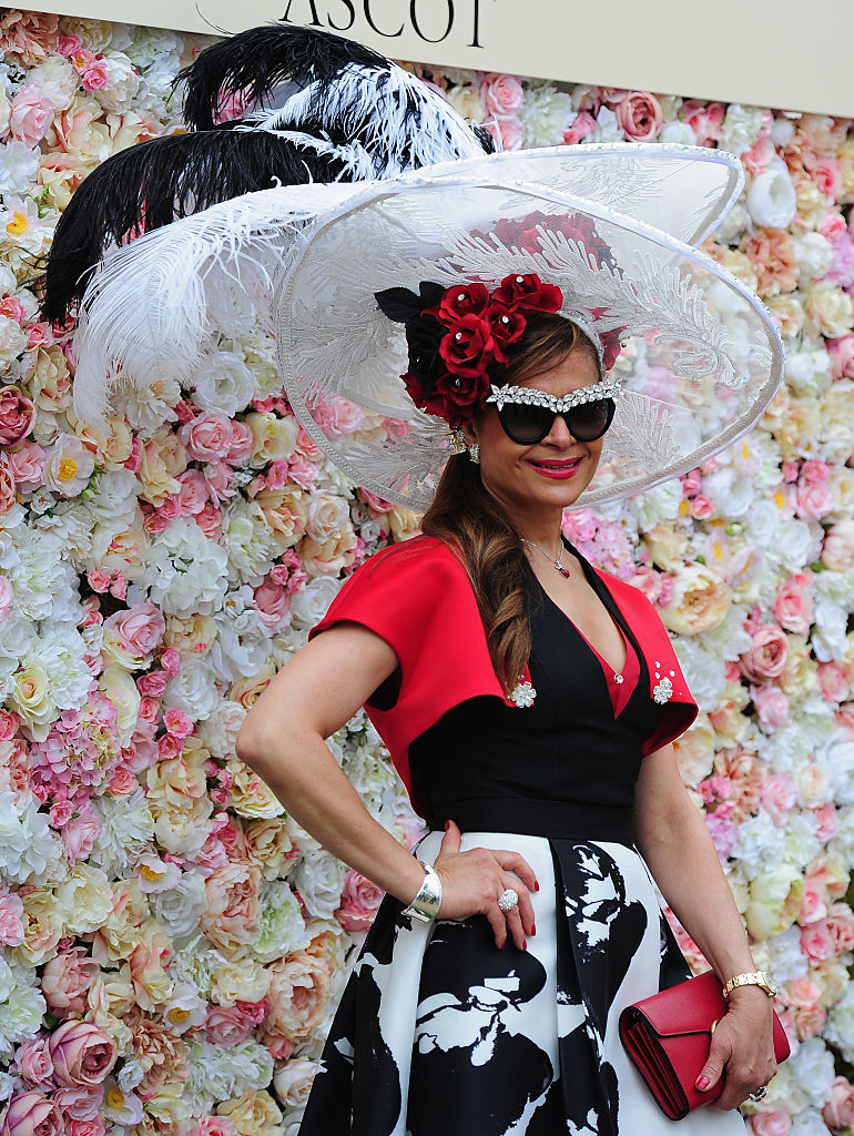 ASCOT, UNITED KINGDOM - JUNE 16: A punter poses for photographs during Day Three of Royal Ascot 2016 at Ascot Racecourse on June 16, 2016 in Ascot, England. (Photo by Harry Trump/Getty Images)