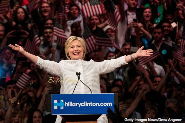 NEW YORK, NY - JUNE 7: Democratic presidential candidate Hillary Clinton arrives onstage during a primary night rally at the Duggal Greenhouse in the Brooklyn Navy Yard, June 7, 2016 in the Brooklyn borough of New York City. Clinton has secured enough delegates and commitments from superdelegates to become the Democratic Party's presumptive presidential nominee. She will become the first woman in U.S. history to secure the presidential nomination of one of the country's two major political parties. (Photo by Drew Angerer/Getty Images)