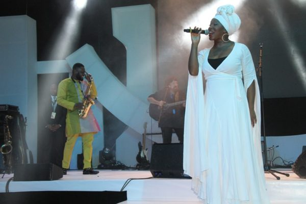 India Arie and Mike Aremu on stage