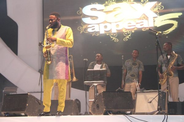 Mike Aremu performing on stage
