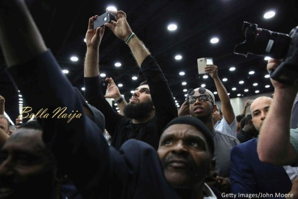 People photograph the casket with the body of Muhammad Ali during at an Islamic prayer service at the Kentucky Exposition Center on June 9, 2016 in Louisville, Kentucky.