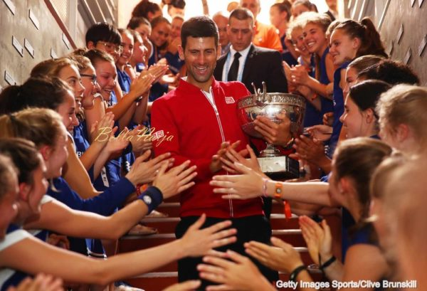 PARIS, FRANCE - JUNE 05: Champion Novak Djokovic of Serbia celebrates with the ball girls following his victory during the Men's Singles final match against Andy Murray of Great Britain on day fifteen of the 2016 French Open at Roland Garros on June 5, 2016 in Paris, France. (Photo by Clive Brunskill for Adidas/Getty Images
