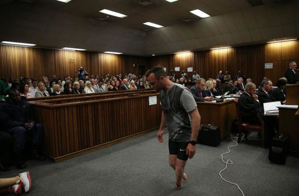 PRETORIA, SOUTH AFRICA - JUNE 15:  Oscar Pistorius walks across the courtroom without his prosthetic legs during the third day of Oscar's hearing for a resentence at Pretoria High Court on June 15, 2016 in Pretoria, South Africa. Having had his conviction upgraded to murder in December 2015, Paralympian athlete Oscar Pistorius is attending his sentencing hearing and will be returned to jail for the murder of his girlfriend, Reeva Steenkamp, on February 14th 2013. The hearing is expected to last five days. (Photo by Siphiwe Sibeko - Pool/Getty Images)