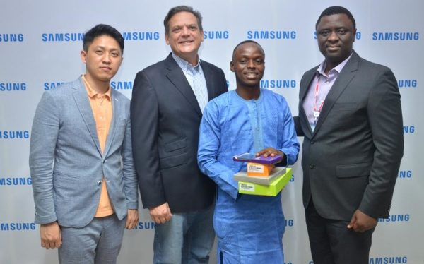 "L-R: Manager, Product Marketing, Mr. Chaejin Im; Director & Business Leader, Information Technology and Mobile, Mr. Emmanouil Revmatas, both of Samsung Electronics West Africa; Winner, Samsung ""Inspire Bigger Dreams"" contest, Muhammed Musa, and Director, Information Technology and Mobile, Samsung Electronics West Africa, Mr. Olumide Ojo during the presentation of Samsung mobile devices and accessories to winners of its just concluded campaign at Samsung Offices, VI"
