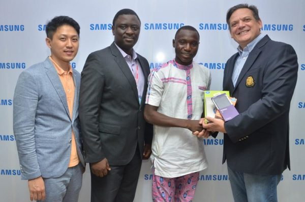 "L-R: Manager, Product Marketing, Chaejin Im; Director, Information Technology & Mobile, Mr. Olumide Ojo, both of Samsung Electronics West Africa; Winner, Samsung ""Inspire Bigger Dreams"" contest, Ibrahim Ambali; and Director & Business Leader, Information Technology and Mobile, Samsung Electronics West Africa, Mr. Emmanouil Revmatas during the presentation of Samsung mobile devices and accessories to winners of its just concluded campaign at Samsung Offices, VI"