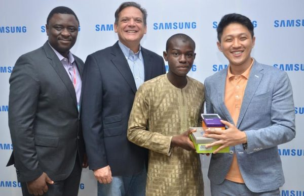 "L-R: Director, Information Technology and Mobile, Mr. Olumide Ojo; Director & Business Leader, Information Technology and Mobile, Mr. Emmanouil Revmatas, both of Samsung Electronics West Africa; Winner, Samsung ""Inspire Bigger Dreams"" contest, Ibrahim Salihu, and Manager, Product Marketing, Samsung Electronics West Africa, Mr. Chaejin Im during the presentation of Samsung mobile devices to winners of its just concluded campaign at Samsung Offices, VI"
