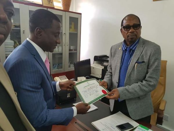 Uche Ogah receiving the Certificate of Return