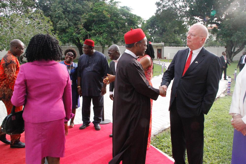 United States Ambassador to Nigeria, James F. Entwistle (right), exchanging pleasantries with former Secretary General of the Commonwealth