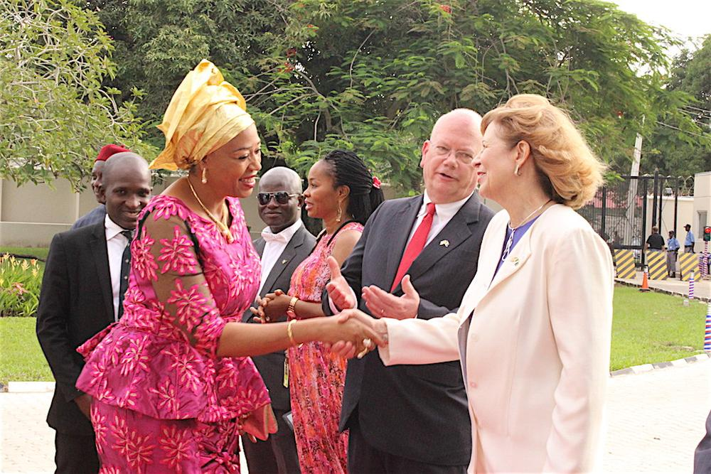 United States Ambassador to Nigeria, James F. Entwistle (middle), with his wife, Dr. Pamela G. Schmoll (right), welcoming the representative of the Nigerian Minister of Foreign Affairs, Vivian Okeke