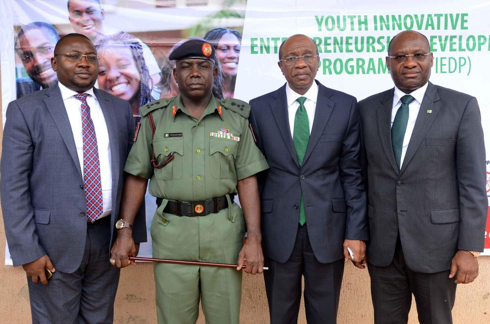 R-L : Heritage Bank Managing Director/CEO Ifie Sekibo; the Central Bank Governor Godwin Emefiele; Director-General of National Youth Service Corps (NYSC), Brig-Gen Sule Kazaure and CBN Deputy Governor Adebayo Adekola Adelabu at the official flag off of the N3billion Youth Innovative Entrepreneurship Development Programme (YIEDP) training for selected candidates at the NYSC Village, Kubwa, Abuja in which Heritage Bank is the pilot partner bank.