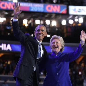 PHILADELPHIA, PA - JULY 27:  US President Barack Obama and Democratic Presidential nominee Hillary Clinton wave to the crowd on the third day of the Democratic National Convention at the Wells Fargo Center, July 27, 2016 in Philadelphia, Pennsylvania. Democratic presidential candidate Hillary Clinton received the number of votes needed to secure the party's nomination. An estimated 50,000 people are expected in Philadelphia, including hundreds of protesters and members of the media. The four-day Democratic National Convention kicked off July 25.  (Photo by Chip Somodevilla/Getty Images)