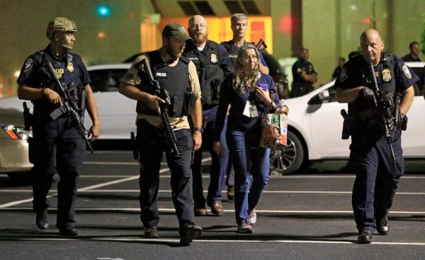 DALLAS, TX - JULY 8:  Dallas police escort a woman near the scene where four Dallas police officers were shot and killed on July 7, 2016 in Dallas, Texas. According to reports, shots were fired during a protest being held in downtown Dallas in response to recent fatal shootings of two black men by police - Alton Sterling on July 5, 2016 in Baton Rouge, Louisiana and Philando Castile on July 6, 2016, in Falcon Heights, Minnesota. (Photo by Ron Jenkins/Getty Images)