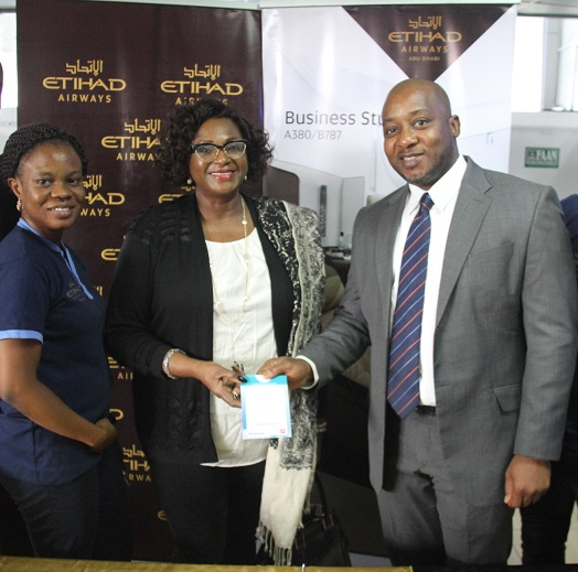 L-R; Marketing lead Etihad Airways Folasade Akinboro, Premium guest, Airport manager Etihad Airways Percival Uwechue