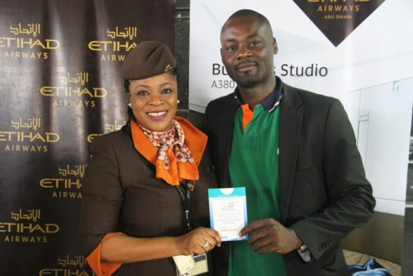 L-R; Airport officer Etihad Airways Bunmi ogunbiyi , Abiodun Sotunde Gold card holder