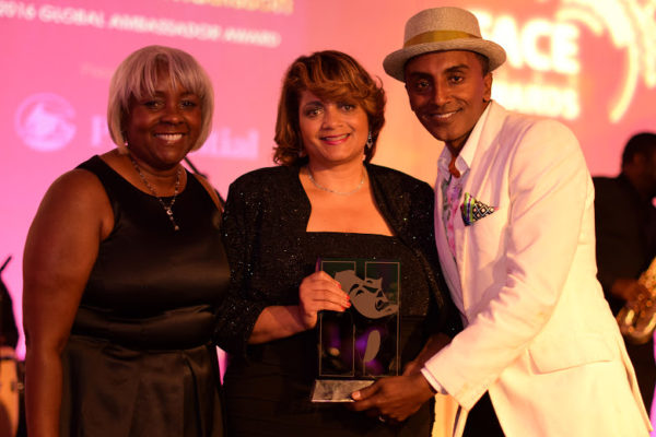 Gale Britton (L) and Dorinda Walker (R) presented the 2016 Global Ambassador Award to Marcus Samuelsson on behalf of Prudential