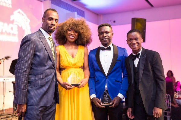 "Surprise guest, ""Beasts of No Nation"" actor Abraham Attah (R) presents the YACE award to the 2016 Fellows"