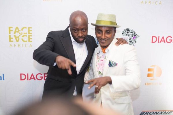 Honorees Wyclef Jean and Marcus Samuelsson share a special moment on the red-carpet