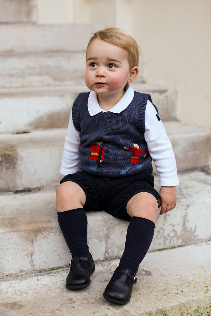 LONDON, ENGLAND - DECEMBER 13 2014: Prince George sits for his official Christmas picture in a courtyard at Kensington Palace in late November of 2014 in London, England. (Photo by The Duke and Duchess of Cambridge/PA Wire via Getty Images)