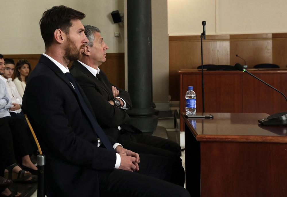 BARCELONA, SPAIN - JUNE 02: Lionel Messi of FC Barcelona and his father Jorge Horacio Messi seen inside the court during the third day of the trial on June 2, 2016 in Barcelona, Spain. Lionel Messi and his father Jorge Messi, who manages his financial affairs, are accused of defrauding the Spanish Tax Agency of 4.1 million Euros ($4.6 million, £3.2 million) by using companies based in tax havens such as Belize and Uruguay to conceal earnings from image rights during years 2007 to 2009. (Photo by Alberto Estevez - Pool/Getty Images)