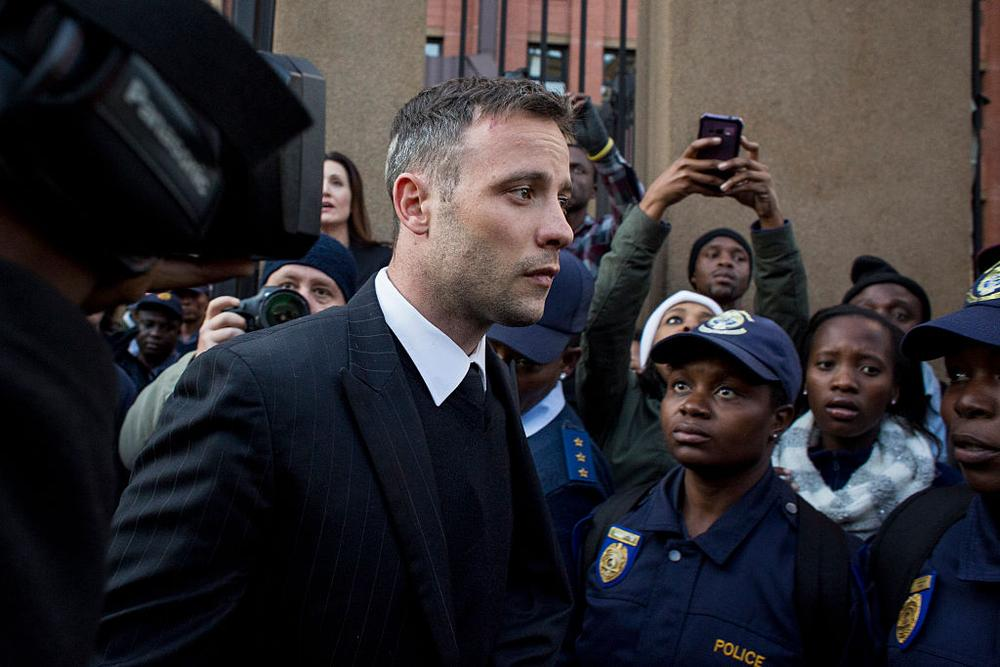 PRETORIA, SOUTH AFRICA – JUNE 15 : Oscar Pistorius leaves the North Gauteng High Court at the end of the day on June 15, 2016 and will return on July 6th for the final sentencing of his murder trial in Pretoria, South Africa. Having had his conviction upgraded to murder in December 2015, Paralympian athlete Oscar Pistorius is attending his sentencing hearing and will be returned to jail for the murder of his girlfriend, Reeva Steenkamp, on February 14th 2013. The hearing is expected to last five days. (Photo by Charlie Shoemaker/Getty Images)