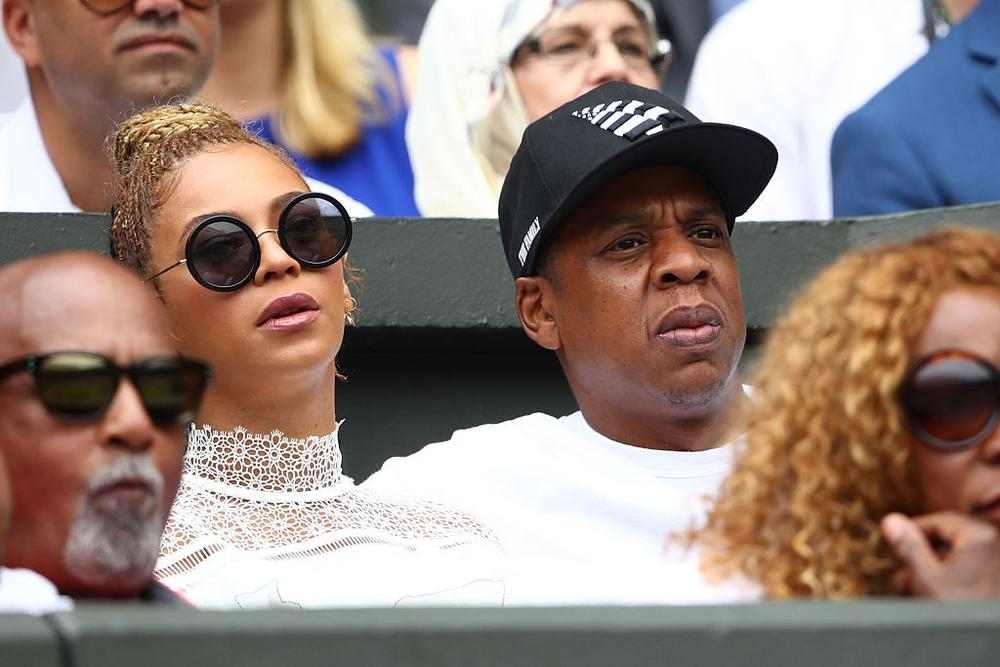 LONDON, ENGLAND - JULY 09:  Jay Z and Beyonce watch on as Serena Williams of The United States and Angelique Kerber of Germany play in the Ladies Singles Final match on day twelve of the Wimbledon Lawn Tennis Championships at the All England Lawn Tennis and Croquet Club on July 9, 2016 in London, England.  (Photo by Clive Brunskill/Getty Images)