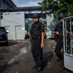 CILACAP, CENTRAL JAVA, INDONESIA - JULY 28:  Indonesian police stand guard at Wijayapura port, the entrance gate to Nusakambangan prison, ahead of a third round of drug executions on July 28, 2016 in Cilacap, Central Java, Indonesia. According to reports, Indonesia is likely to resume executions of 14 prisoners on death row this week. Fourteen prisoners, including inmates from from Nigeria, Pakistan, India, South Africa, and four Indonesians, have been moved to isolation holding cells at Nusa Kambangan, off Central Java.  (Photo by Ulet Ifansasti/Getty Images)