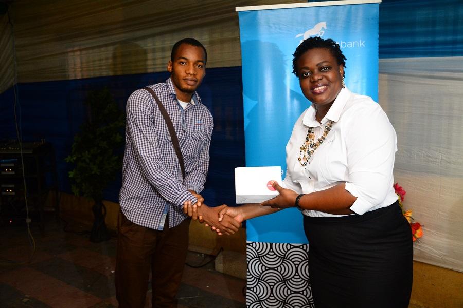 Omotola Oyebanjo presenting gifts to participants