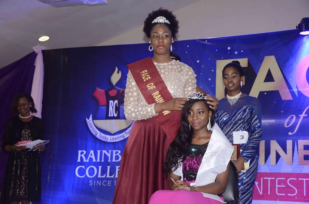 Outgoing Queen, Stephanie Umeh presenting the Crown to the incoming Queen - Amira Okoro