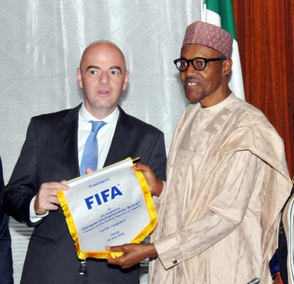 PIC. 20. PRESIDENT MUHAMMADU BUHARI (R), RECEIVING A PENNANT FROM FIFA PRESIDENT, GIANNI INFANTINO, DURING THE LATTER'S VISIT TO THE PRESIDENTIAL VILLA IN ABUJA ON MONDAY (25/7/16). 5312/25/7/2016/ICE/EO/BJO/NAN