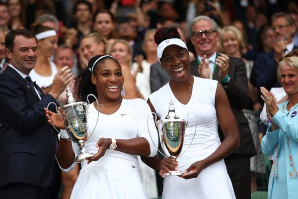 LONDON, ENGLAND - JULY 09: Venus Williams of The United States and Serena Williams of The United States celebrate victory in the Ladies Doubles Final against Timea Babos of Hungary and Yaroslava Shvedova of Kazakhstan on day twelve of the Wimbledon Lawn Tennis Championships at the All England Lawn Tennis and Croquet Club on July 9, 2016 in London, England.