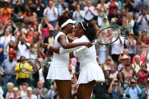 LONDON, ENGLAND - JULY 09: Venus Williams of The United States and Serena Williams of The United States celebrate victory in the Ladies Doubles Final against Timea Babos of Hungary and Yaroslava Shvedova of Kazakhstan on day twelve of the Wimbledon Lawn Tennis Championships at the All England Lawn Tennis and Croquet Club on July 9, 2016 in London, England. (Photo by Clive Brunskill/Getty Images)
