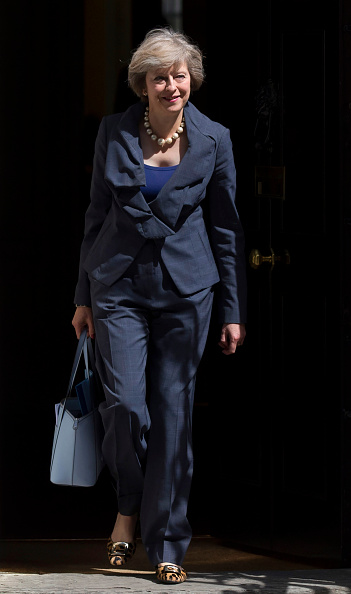 LONDON, ENGLAND - JULY 12: Prime Minister-in-waiting, Theresa May, leaves after attending a Cabinet meeting at Downing Street on July 12, 2016 in London, England. David Cameron will step aside tomorrow (Wednesday) after his final Prime Minister's Questions allowing current Home Secretary Theresa May to move into 10 Downing Street. She was selected unopposed by Conservative MPs to be their new leader. (Photo by Carl Court/Getty Images)