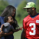 Seattle Seahawks quarterback Russell Wilson, right, walks with his girlfriend, entertainer Ciara Harris, and Harris' son Future, 1, Thursday, Aug. 13, 2015, following NFL football training camp in Renton, Wash. (AP Photo/Ted S. Warren) ORG XMIT: OTK