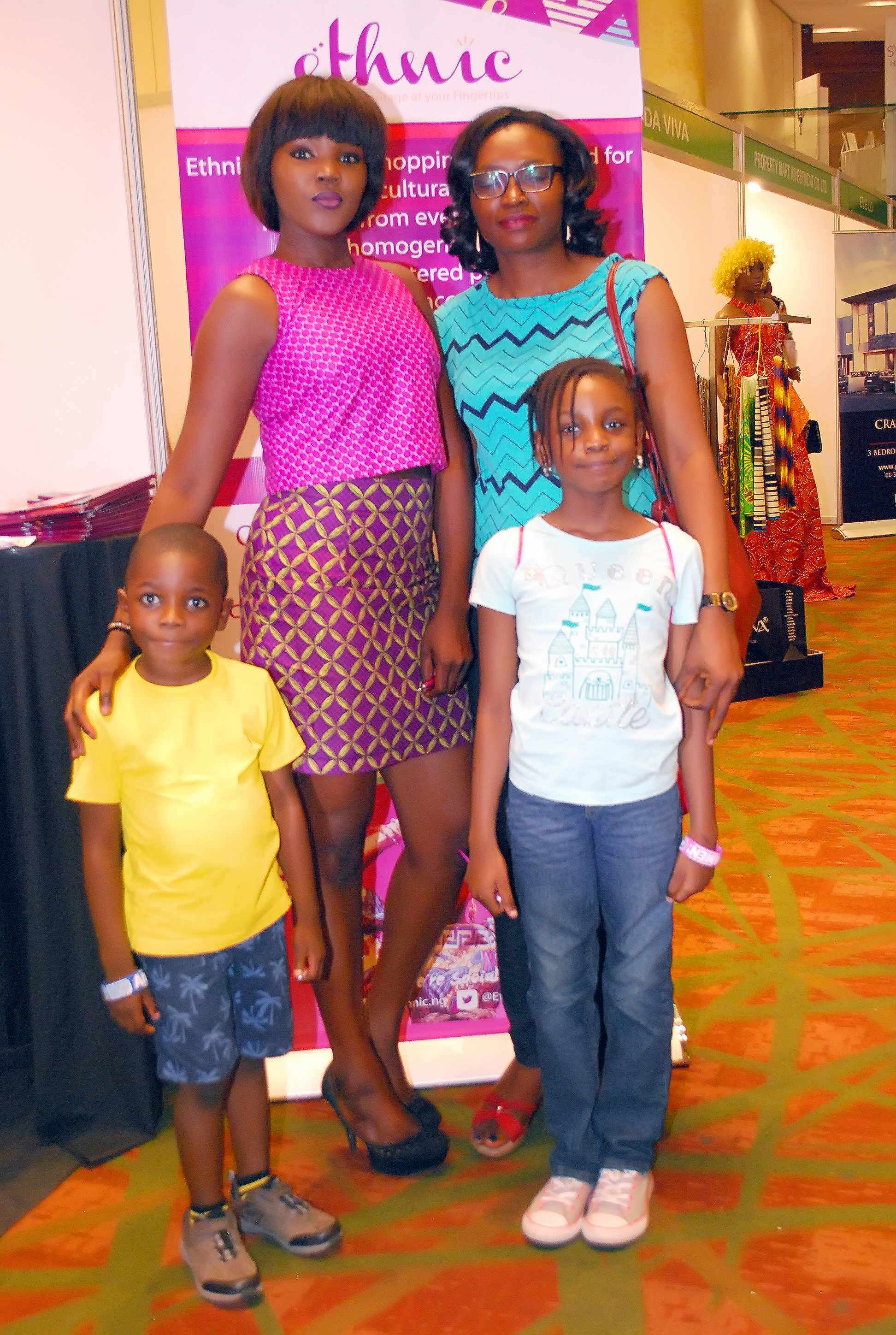 excited guest and her kids with Ethnic's pretty usher