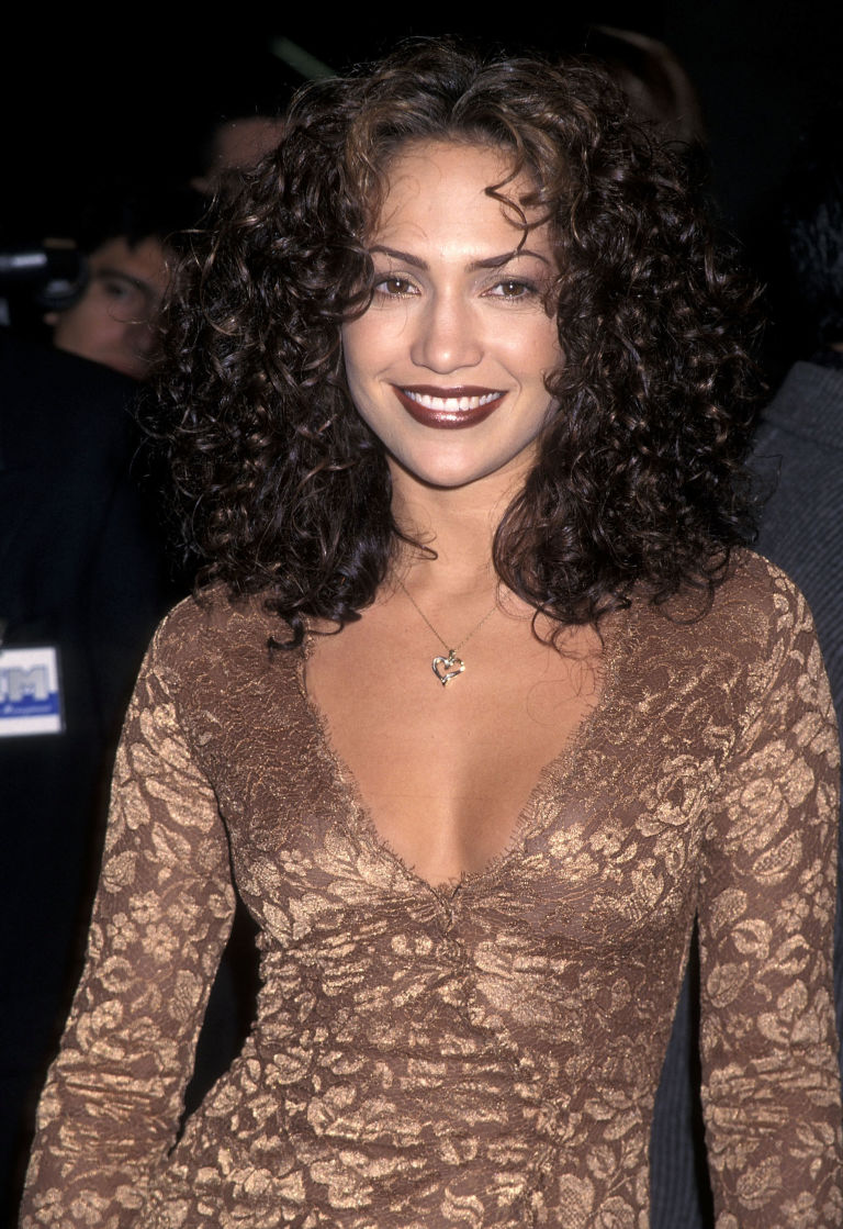 JLo wearing a super shiny brown lip. From 1997.