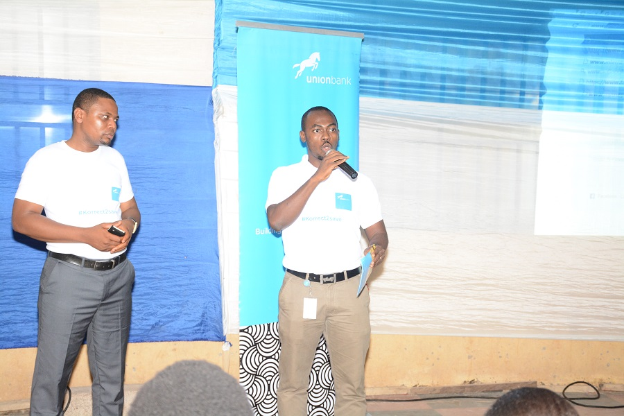 kenneth Alozie, HNI Relationship Manager and colleague addressing the students