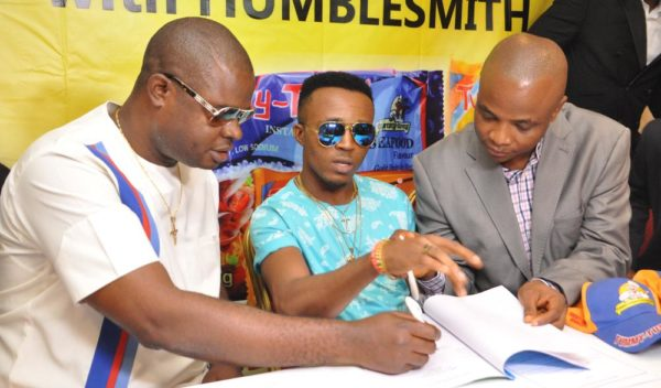 Chief Ogo Emenike,Managing Director,Tummy Tummy Foods Industries Limited;Ijemba Ekenedilichukwu[Humblesmith]Brand Ambassador and Mr. Chijioke Anumoka,General Manager,Tummy Tummy Foods Industries Limited.At the Unveiling of Humble smith as Brand Ambassador of Tummy Tummy Foods Industries Limited in Lagos yesterday.