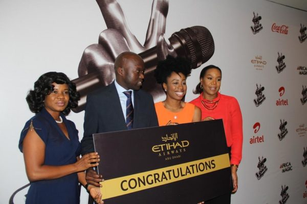 (L-R) Folashade Akinboro, Etihad Marketing Officer, Nigeria; George Mawadri, Etihad Airways' General Manager, Nigeria; Agharese Emokpae, winner of the first season of The Voice Nigeria and Wangi Mba-Uzoukwu, Director, M-Net, West Africa at the prize presentation of  her tickets to Abu Dhabi by Etihad Airways recently