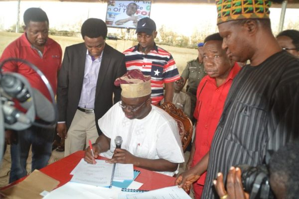 Gov Fayose during the signing of the Bill