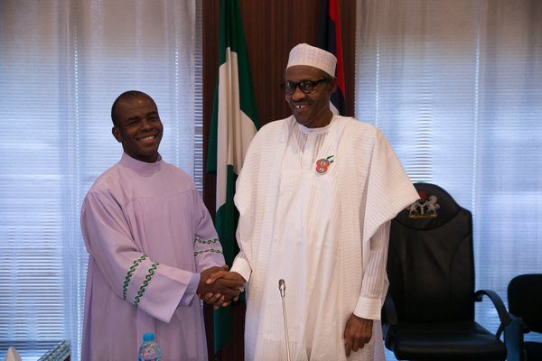 President Buhari (R) and Father Mbaka (L)