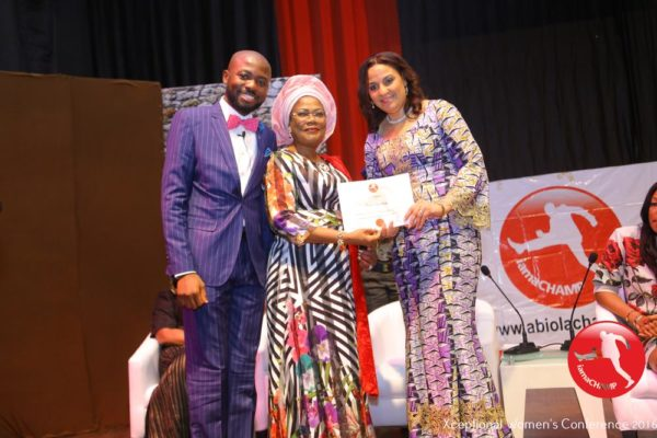 Clare Omatseye receiving The Xceptional Women's Role Model Award