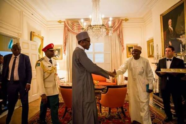 Garba Shehu in handshake with President Buhari
