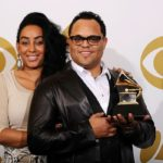 "LOS ANGELES, CA - FEBRUARY 13:  Musician Israel Houghton (R), winner of the Best Gospel Performance award for ""You Hold My World"" and Meleasa Houghton pose in the press room at The 53rd Annual GRAMMY Awards held at Staples Center on February 13, 2011 in Los Angeles, California.  (Photo by Kevork Djansezian/Getty Images)"